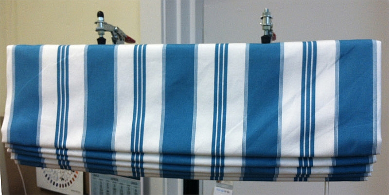 Relaxed Roman shade in blue and white striped fabric