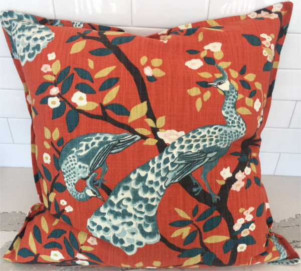 Custom pillow with peacocks on burnt orange background