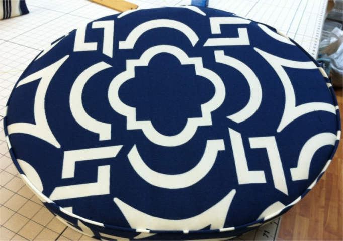 Round pillow, white geometric pattern on blue background