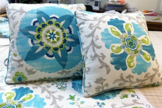 Square pillows of flower and leaf pattern with fabric piping