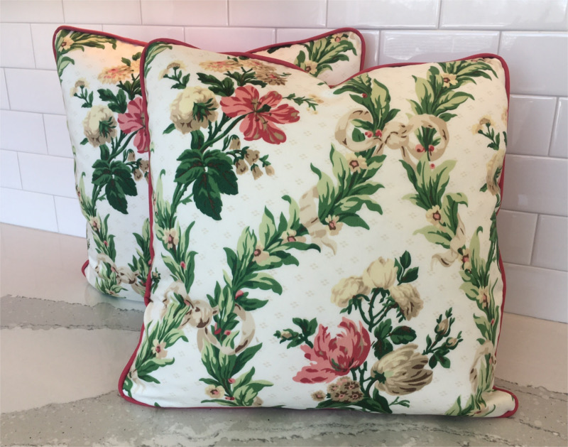 Flower-patterned square pillows with accent color piping