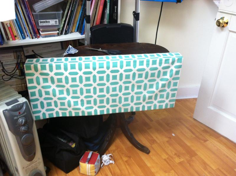 Valance in the work room, fabric doorstop on floor