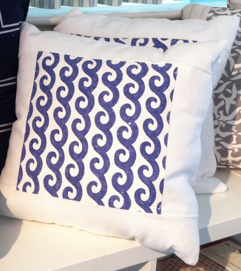 Throw pillows with contrasting center of patterned fabric in a perfect square