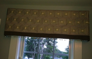 Valance of geometric pattern with solid color border and fringe below