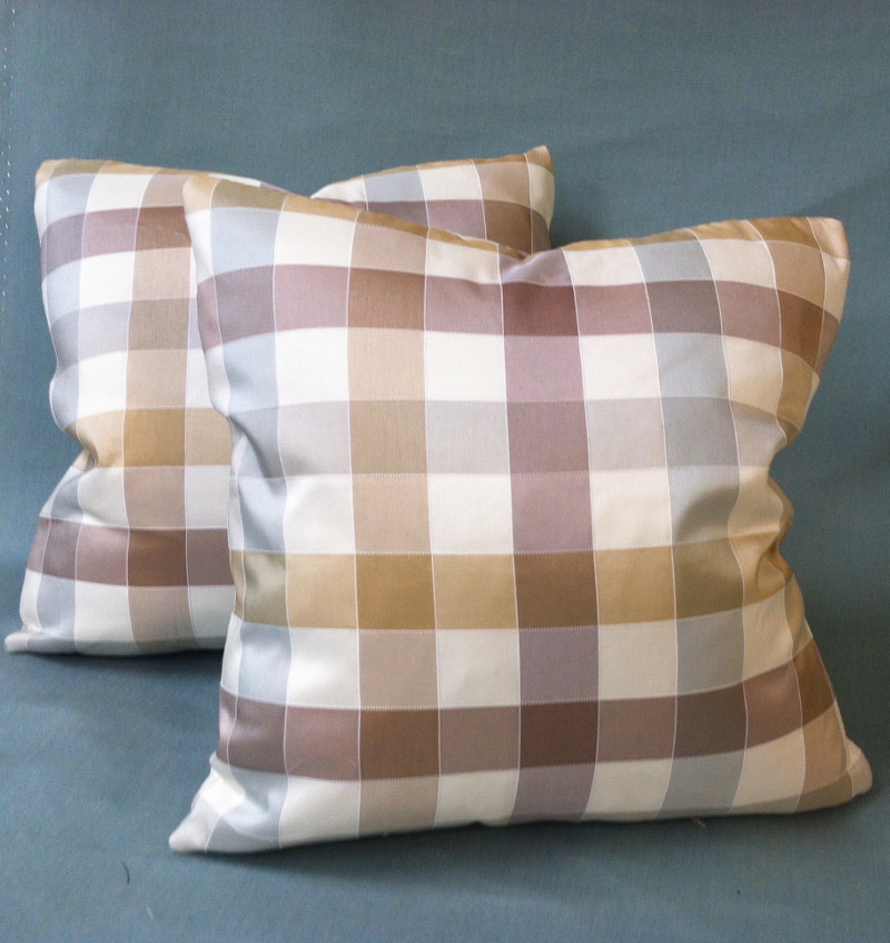 Two perfectly matching throw pillows of large checked pattern