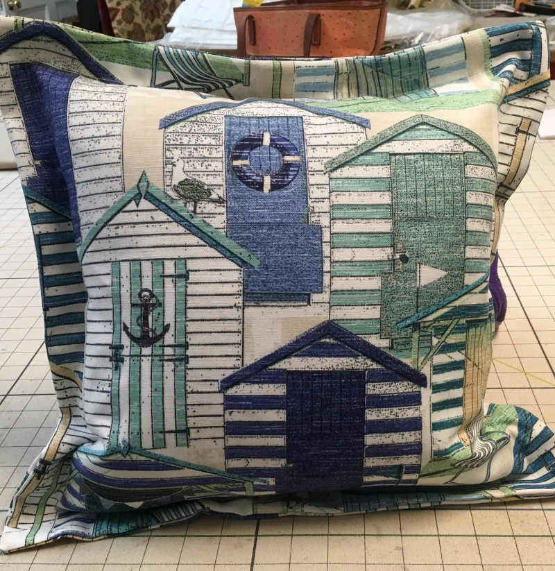 Square throw pillow with deep stitched edges