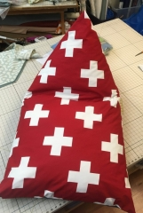 Uniquely shaped pillow, red with white crosses