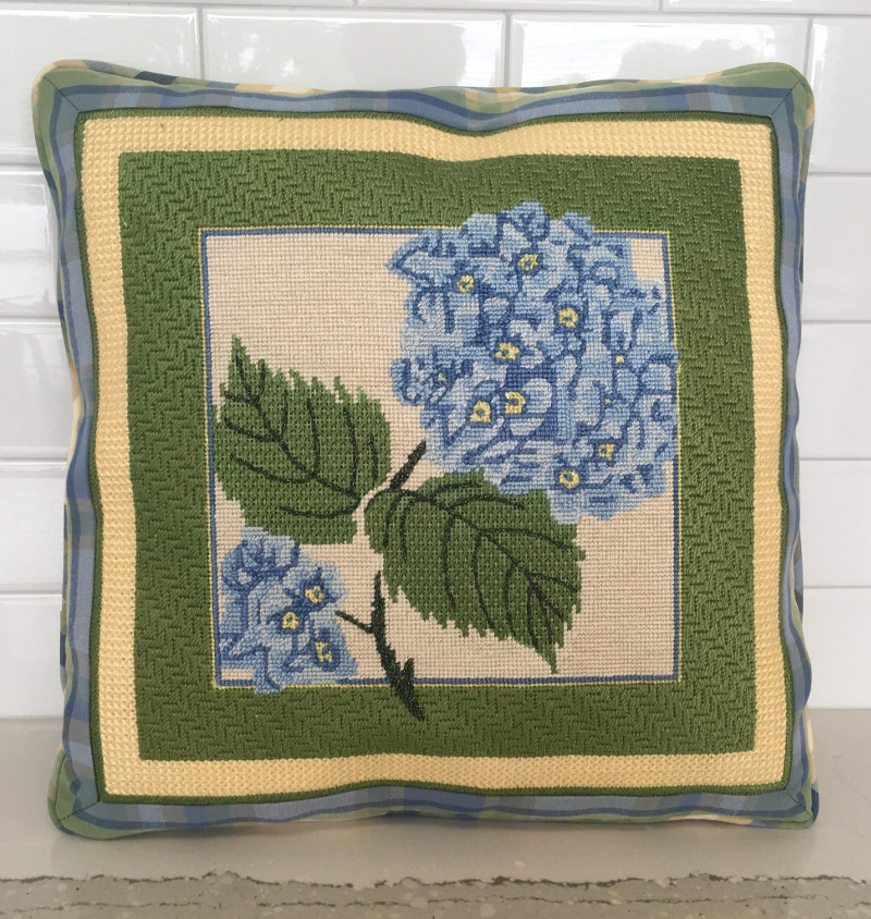 Embroidered hydrangea as pillow face with layers of different colored fabric as border