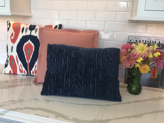Three throw pillows with various details, showcasing the diversity of designs possible by SeaCheryl Designs