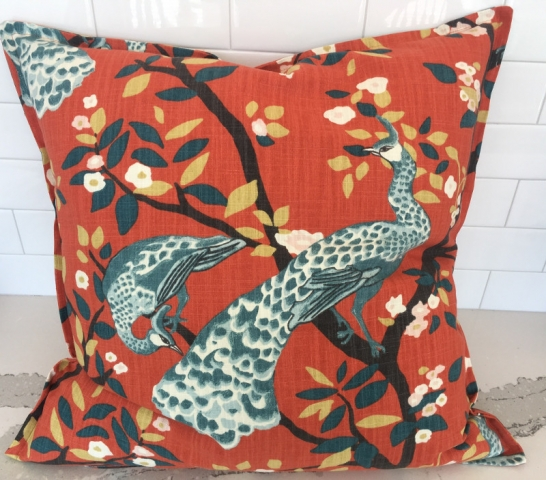 Patterned square throw pillow with stitched border