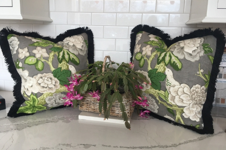 Perfectly matched patterned throw pillows with thick thread edging