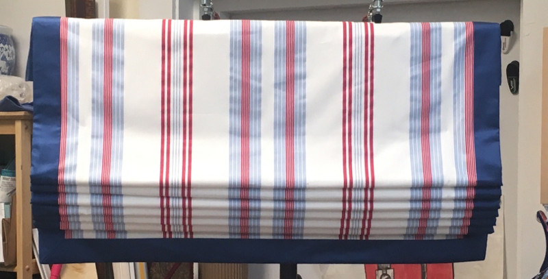 Fabric roman shades with striped pattern