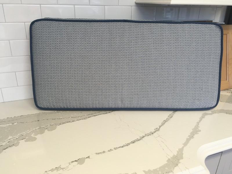 Rectangular bolster cushion of herringbone pattern with piped edging