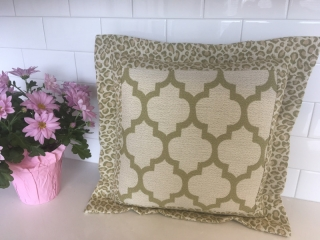 Square throw pillow with two fabrics