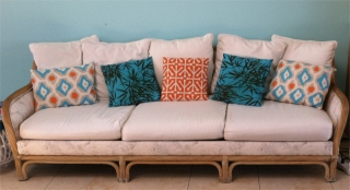 Custom couch cover, cushions, and throw pillows of hand-sewn fabrics in varying colors
