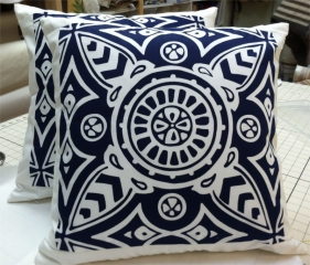 Navy blue patterned fabric squares perfectly positioned as covers on square pillows