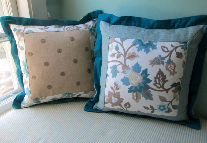 Throw pillows with multiple panels of fabrics and stitched edges