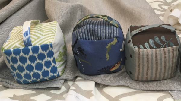 Fabric doorstops with handles, various fabrics
